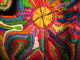 embroidered-coat-detail-sun.jpg