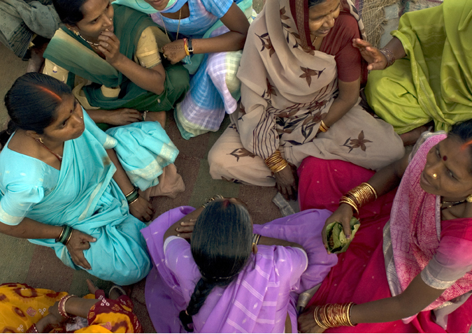 circle of women in India, photo by Brian Harris